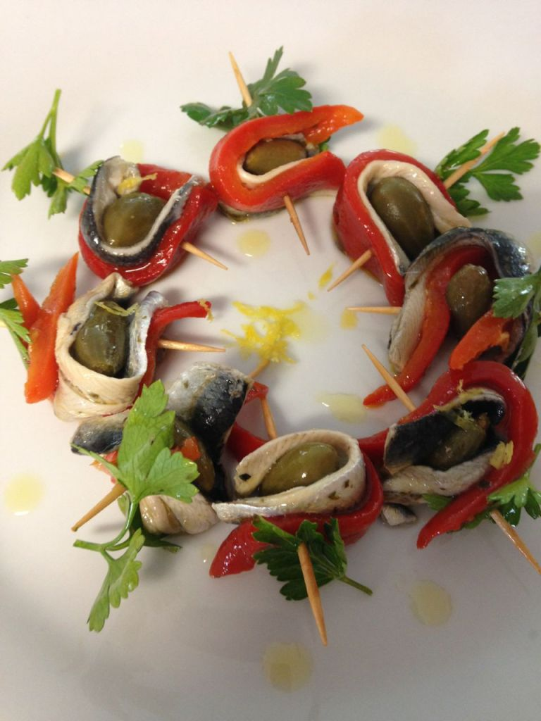 Pintxos: Boquerones, caper berries and piquillo peppers.